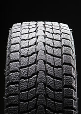 winter tire traction is enhanced by adding pumice to the rubber compound